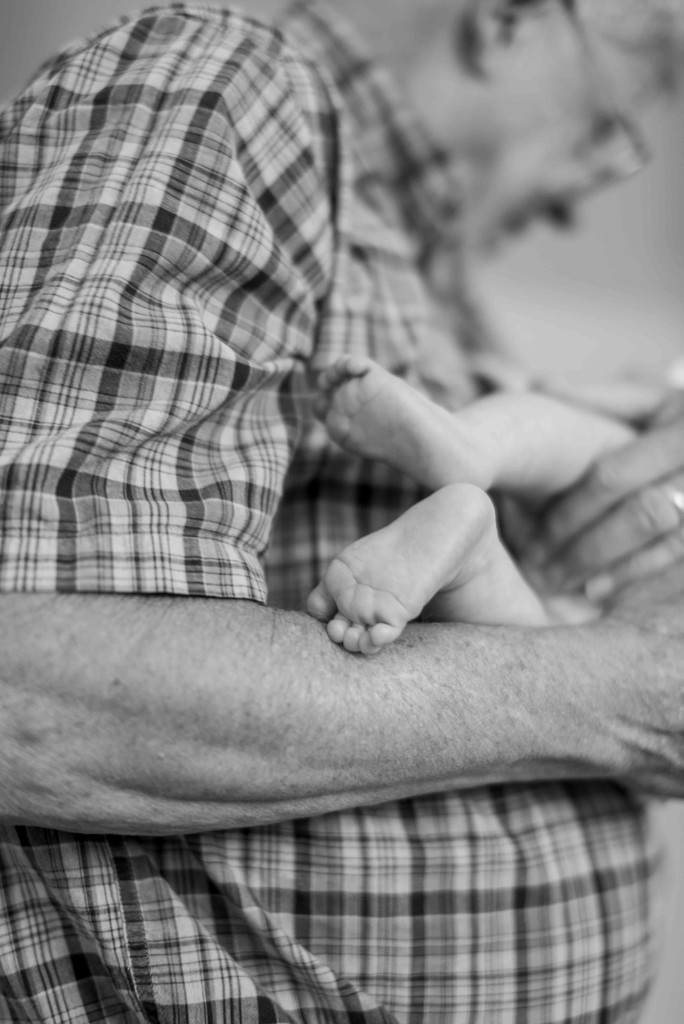 grandfather and baby feet
