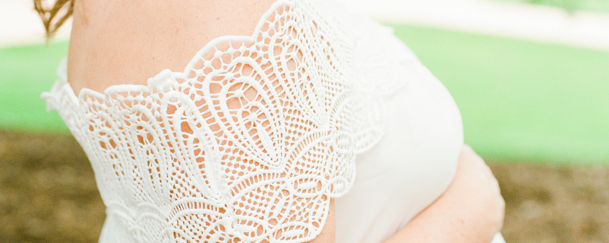 white lace dress maternity session