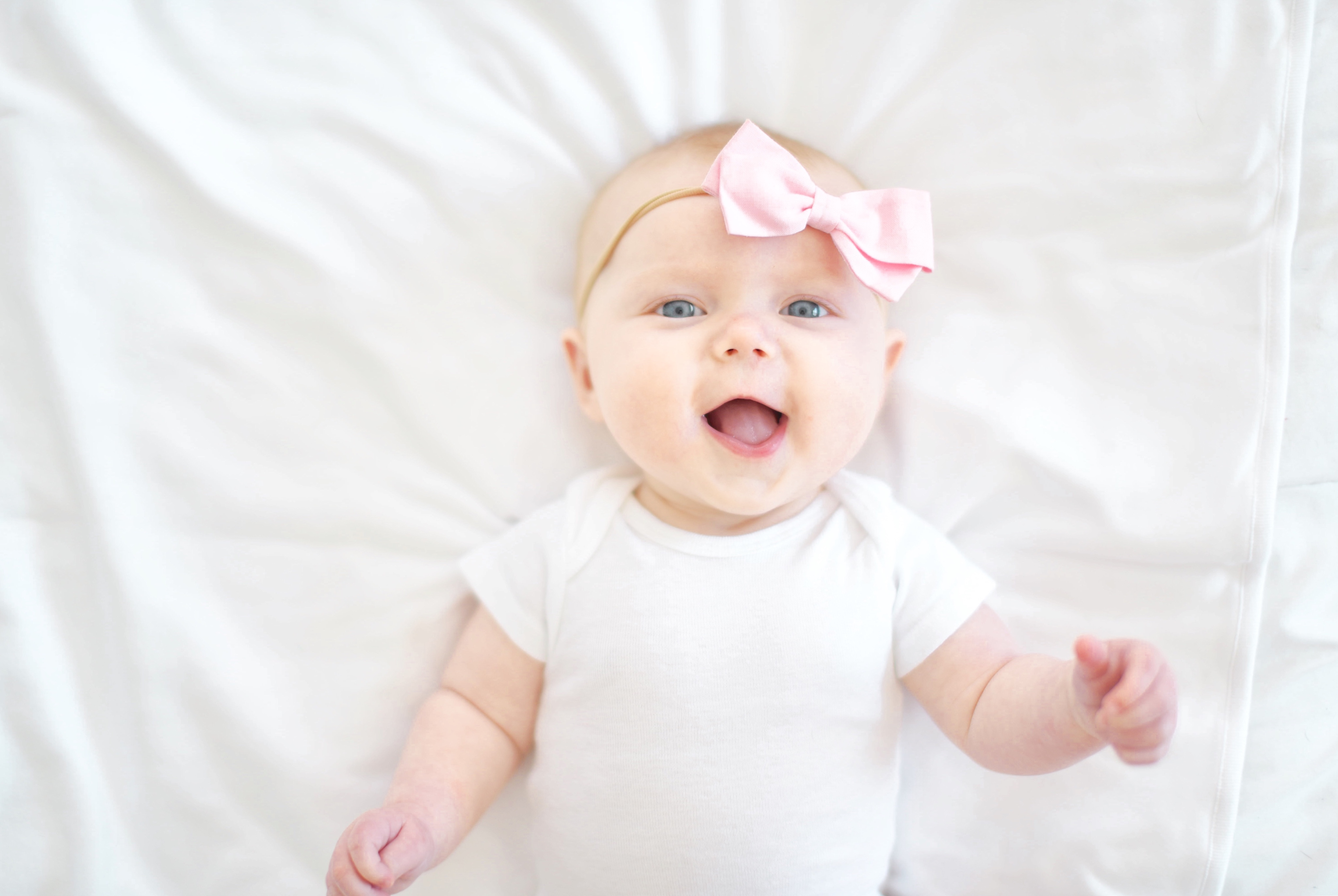 baby girl in a pink bow hospital new mom baby must have list