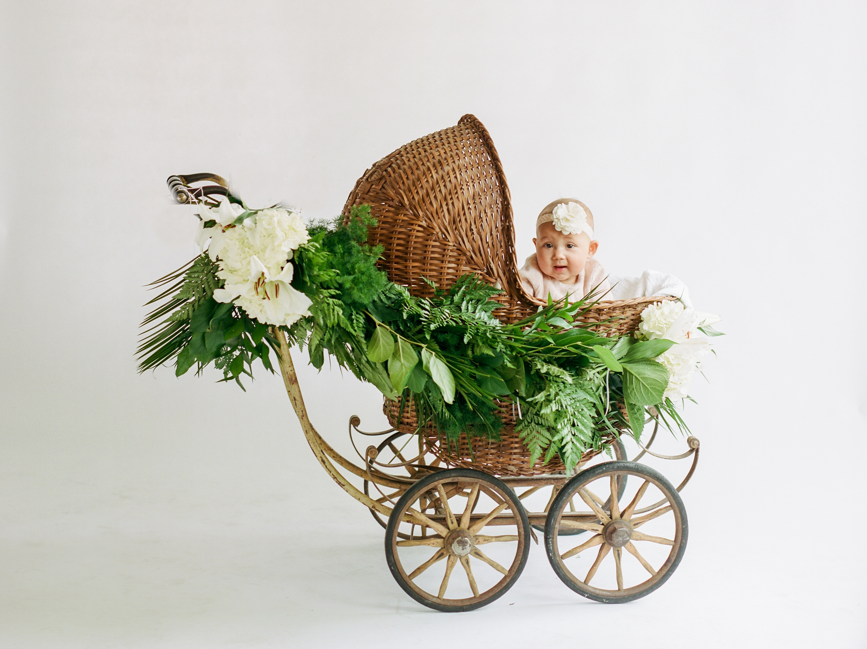 baby girl in vintage antique buggy carriage