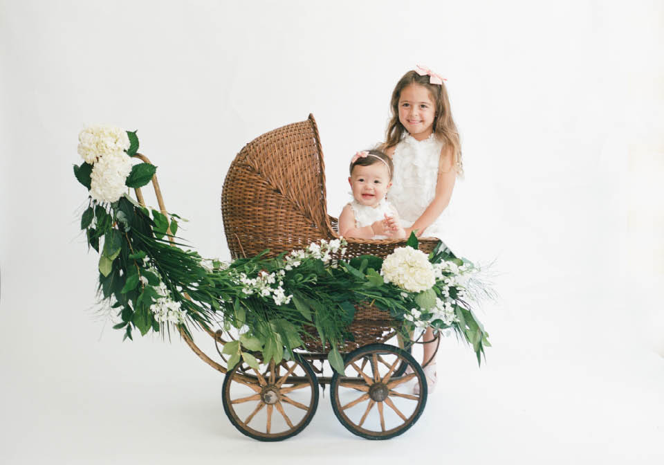 Sisters in antique buggy